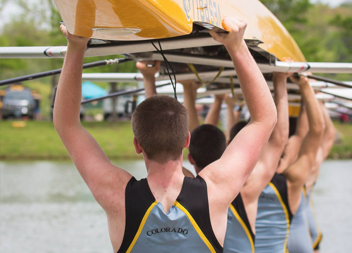 rowing team holding their boat