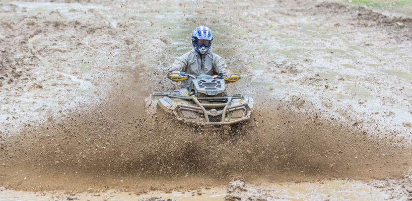 atv driver in mud