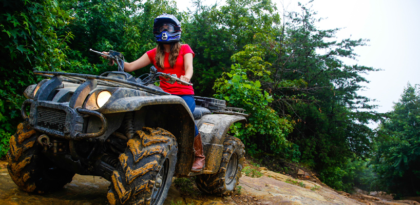 woman driving an ATV
