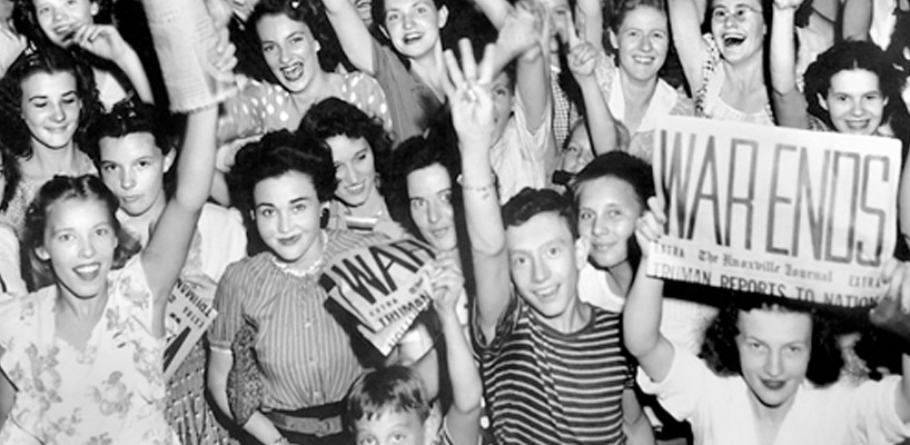 young adults smiling and holding war ends signs