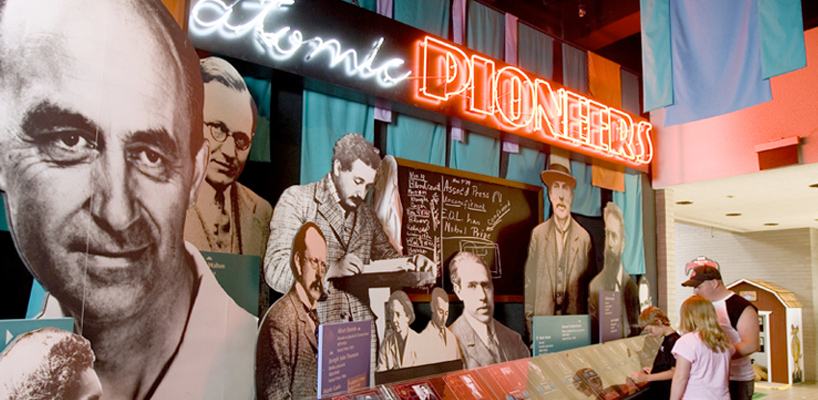 museum display of iconic figures from the creation of the atomic bomb