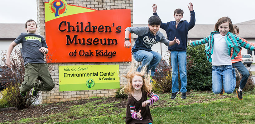 children's museum of oak ridge sign with happy kids in front of it