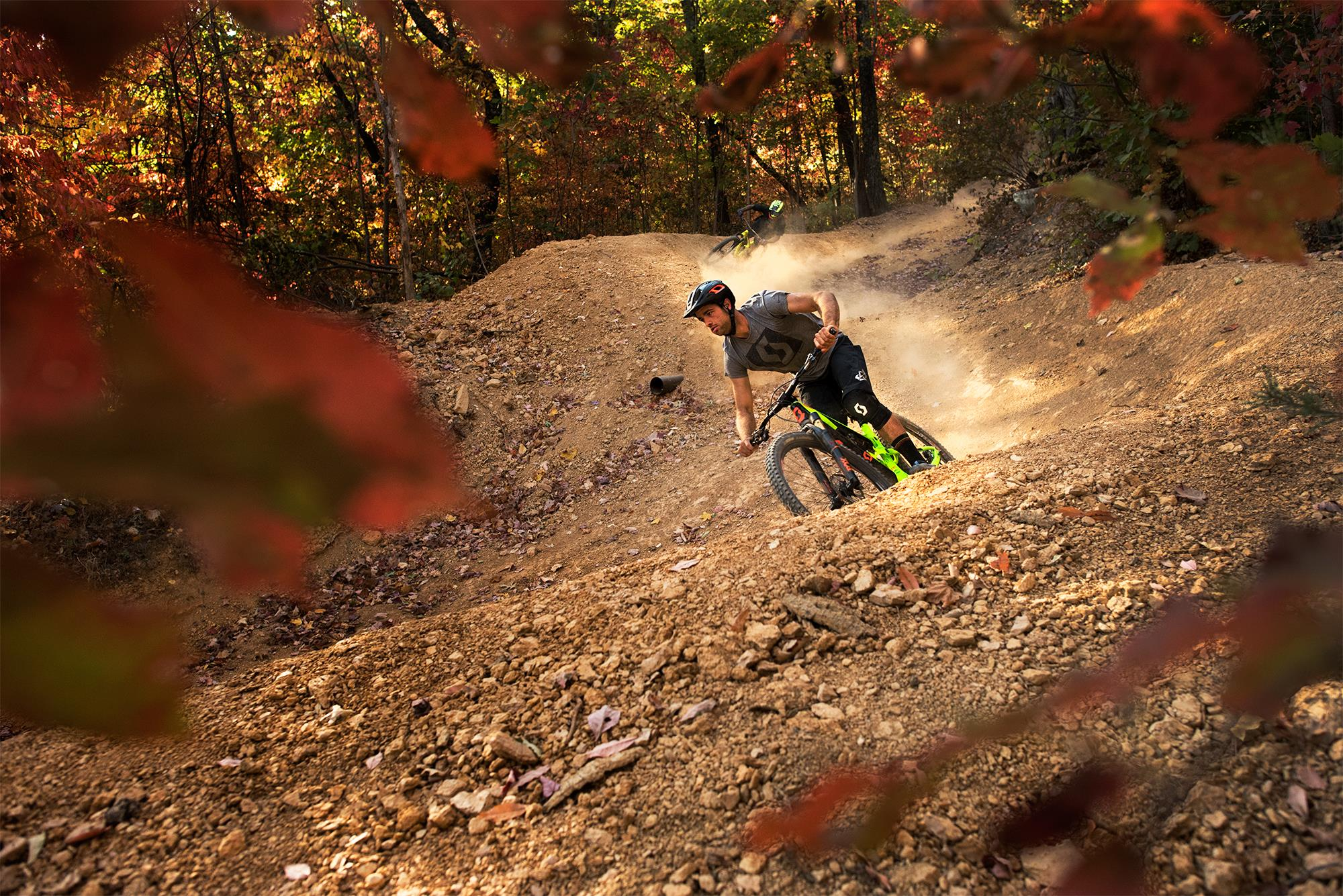 man riding a mountain bike in the woods