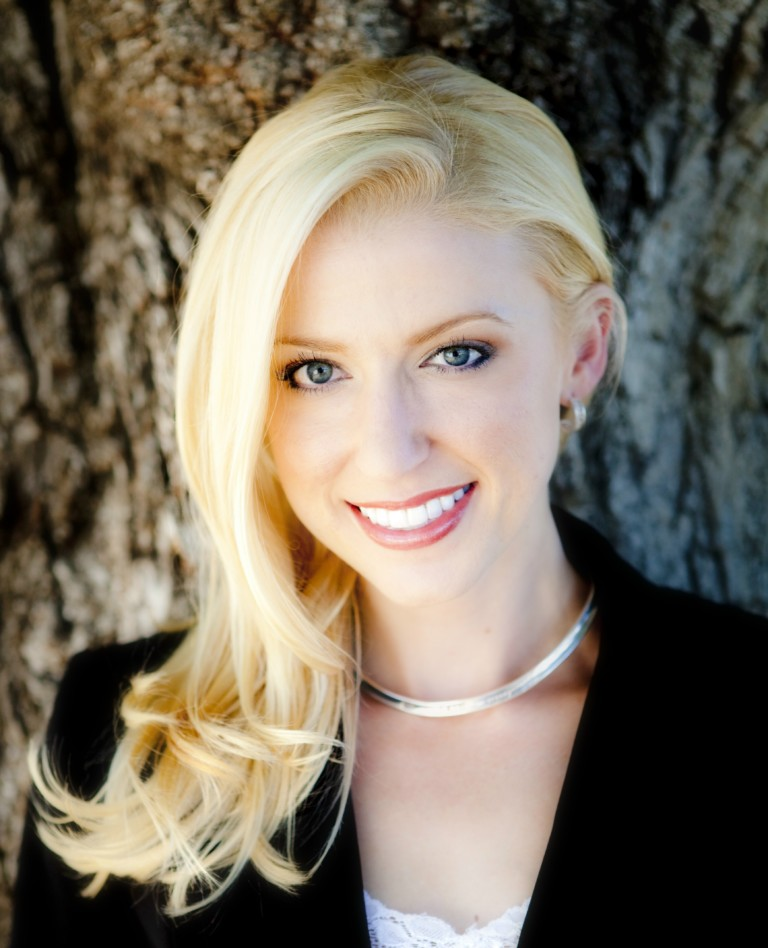 head shot of smiling blonde woman