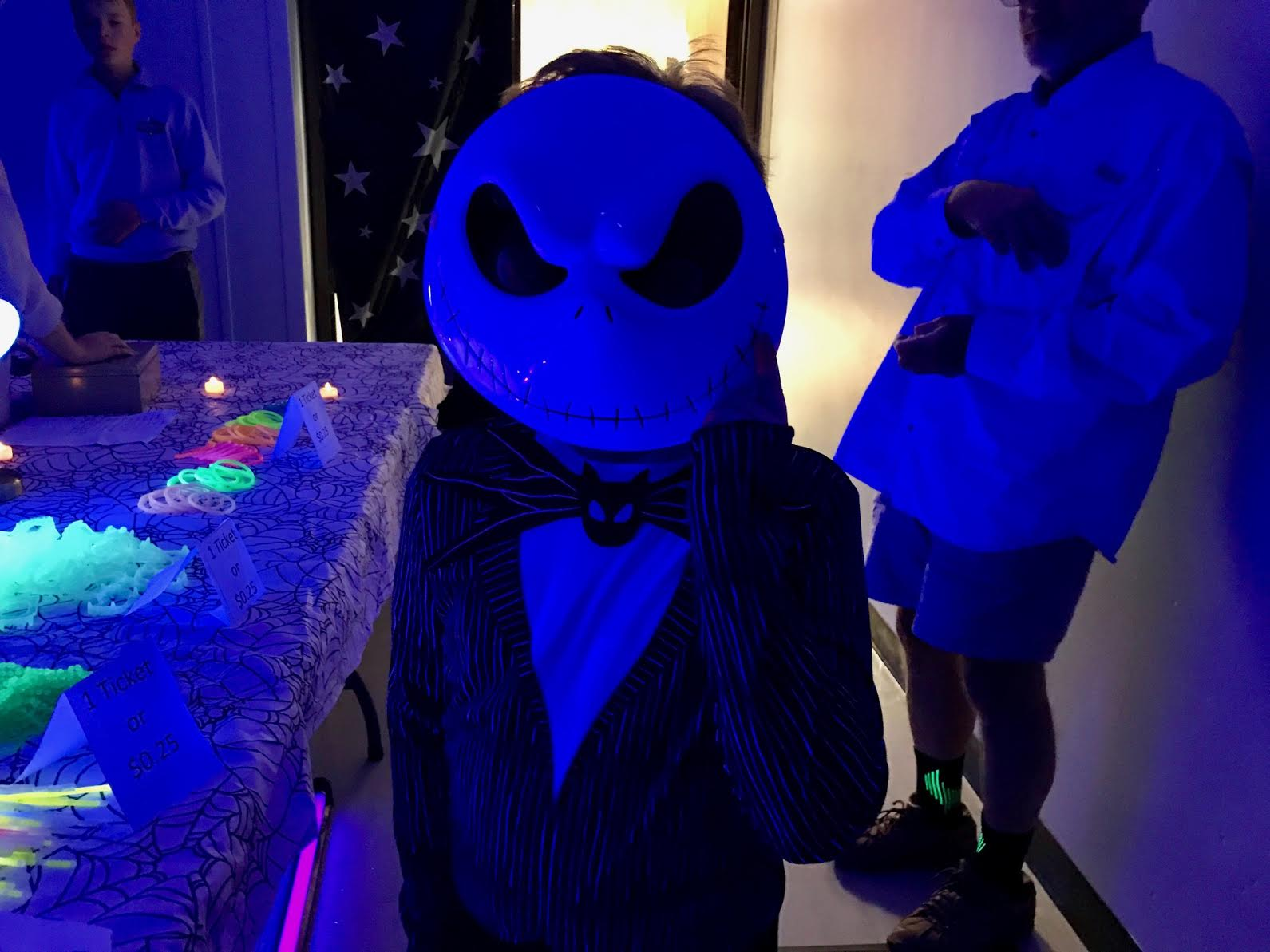 kid wearing a jack skullington costume