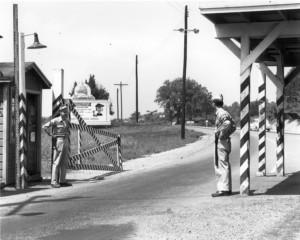 Guards at an entrance to Oak Ridge during World War II.