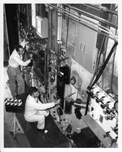 Men working with scientific equipment in Oak Ridge during WWII.