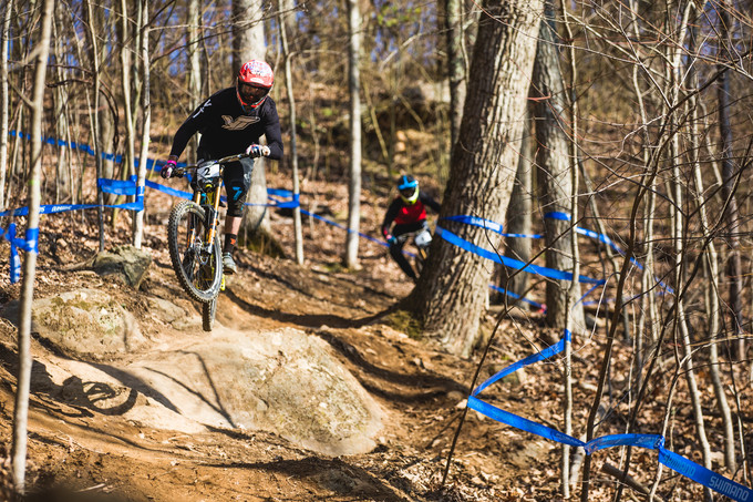 biker catching air on mountain bike path at haw ridge park