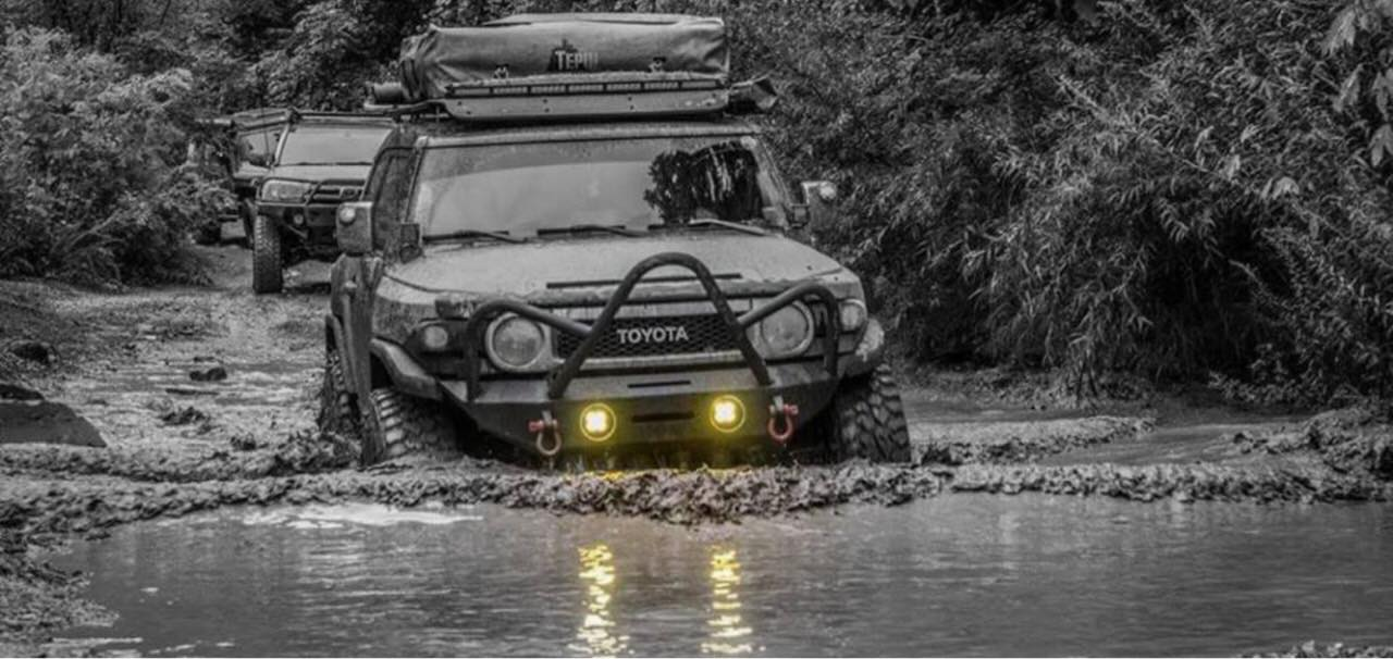 Toyota FJ going through high muddy water