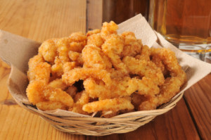 A basket of fried clam strips.