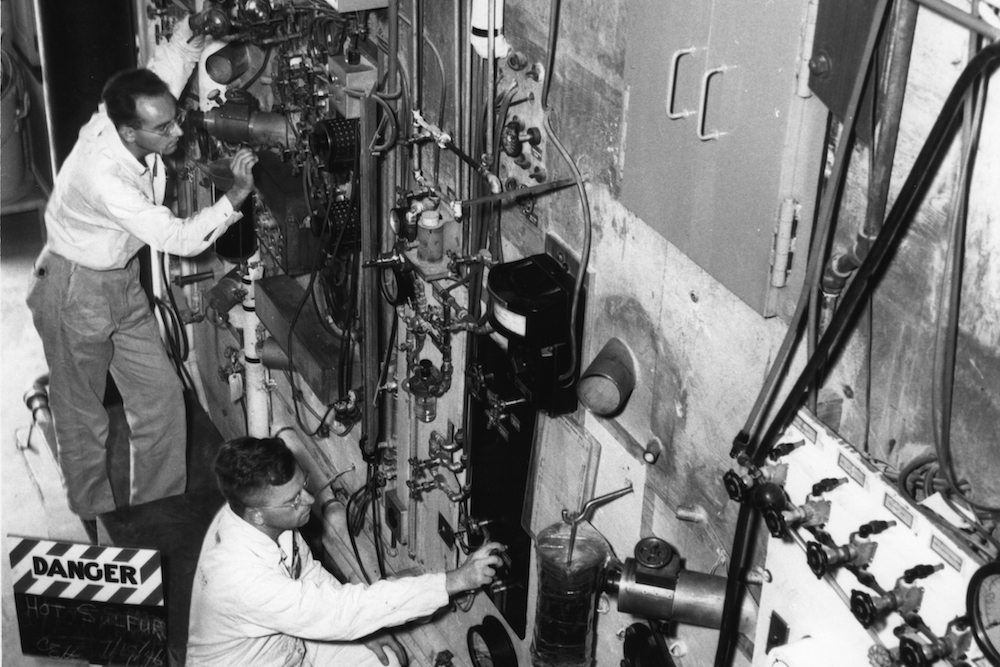 Men working on the back of the X-10 Graphite Reactor in Oak Ridge.